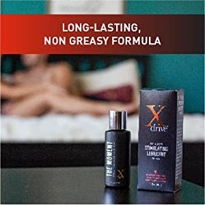 Bottle & box on black counter, couple in bed behind; text reads: long-lasting, non-greasy formula