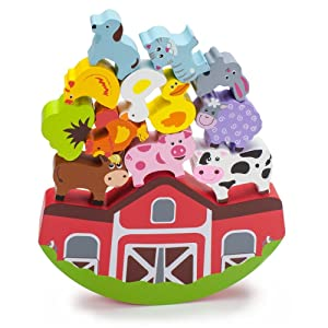 Wooden farm animals stacked on top of a wooden barn.