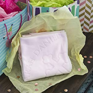 Personalized pink baptism blanket in gift wrap with presents