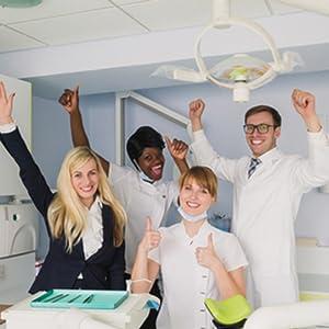 plastcare dental office dentist staff team happy cheering