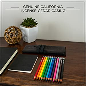 "12 Blackwing colored pencils on desk with notebooks, words ""genuine california incense-cedar casing"""