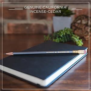 "Sleek Blackwing pencil on a black notebook beneath the words ""genuine california incense-cedar"""