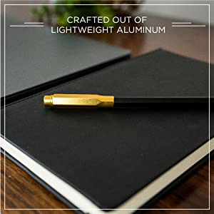"""Gold Blackwing Point Guard and pencil on a Slate Journal, """"crafted out of lightweight aluminum"""""""