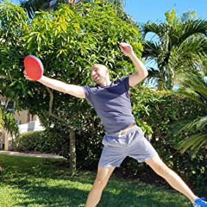 easy disk frisbee that is soft with guy playing under the sun in summer in the park and beach