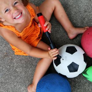Child using a ball pump