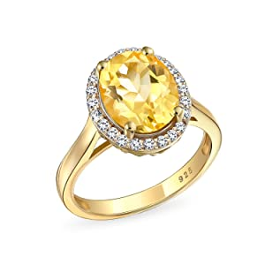 Oval Shaped Citrine Halo Ring