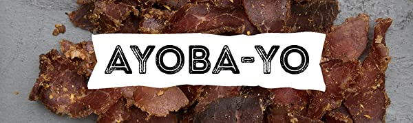Ayoba-Yo Logo in front of Grass-Fed Beef Biltong that is Paleo and Keto Certified.