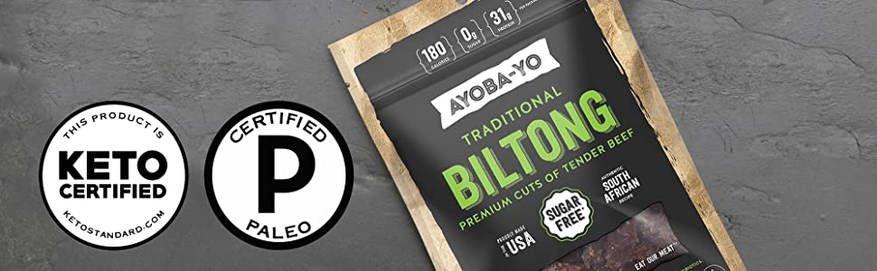 Biltong Beef Jerky that is Paleo Certified and Keto Certified on slate in bag.