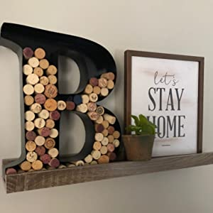 wine wall sign shown with succulent and decorative picture