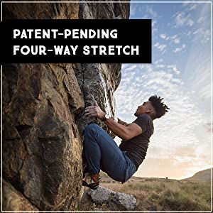 "Man rock climbing in blue Trailhead Adventure Pants, ""Patent-pending, 4-way stretch"""