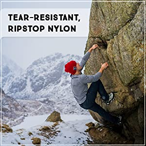 "Man rock climbing in the snow, ""tear-resistant, ripstop nylon"""