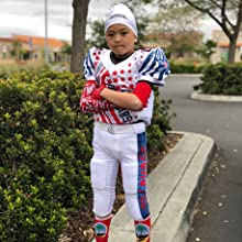 youth football player wearing a arm sleeve from b driven sports