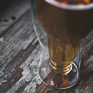 beer cup on wood table