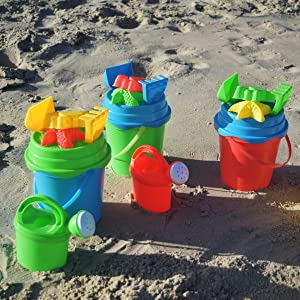 3 assorted color sand buckets by beachgoer