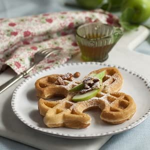 Fleur de Lis waffle with walnuts and powdered sugar