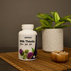 milk thistle supplement bottle and capsules