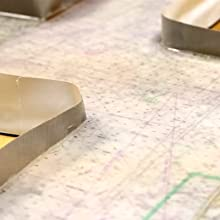 Apply tape to the outer edges to contain the TotalBoat TableTop Epoxy before pouring onto surface