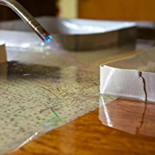Waving a torch quickly over the surface to pop bubbles in TotalBoat clear TableTop Epoxy.