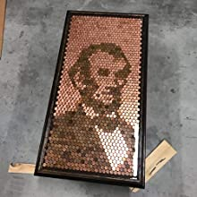 TotalBoat clear TableTop Epoxy used to embed pennies in a design depicting Abraham Lincoln by Vince