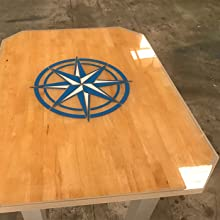 Custom tabletop made using a Compass Rose graphic embedded in TotalBoat clear TableTop Epoxy by Joe