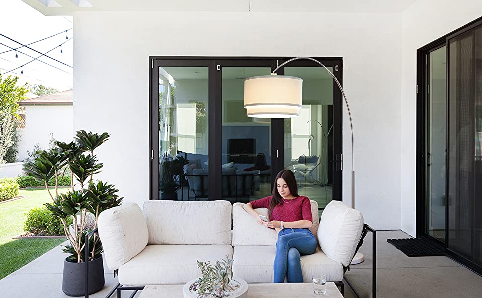 Brightech Mason Arc Floor Lamp With Unique Hanging Drum Shade Arching Over The Couch From