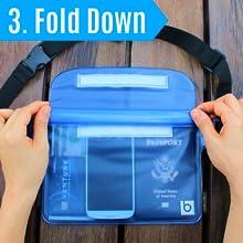 Woman folding down the three waterproof zip lock seals on the waterproof pouch.