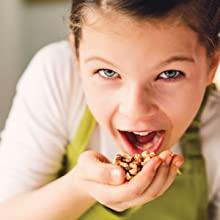 child eating handful of Grower Direct Nut walnuts