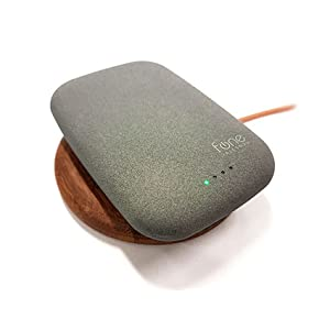 QiStone+ charging on top of a WoodPuck wireless charger.
