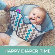"""A grey travel diaper changing pad. Text reads """"Happy Diaper-Time."""""""