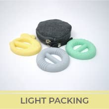 """Three teether buckle rings in yellow, grey, and blue. Text reads """"Light Packing."""""""