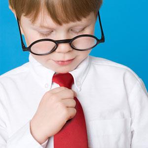 Boy wear his own tie