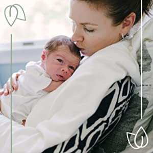 Mother holding newborn and kissing his head, Benefits of Prenatal Brilliance