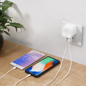 This wall charger is charging two phones simultaneously
