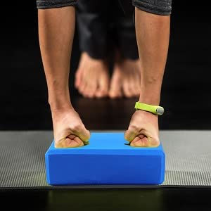 women practicing yoga therapy stretching in down dog using blocks