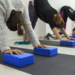 Stretching with yoga blocks