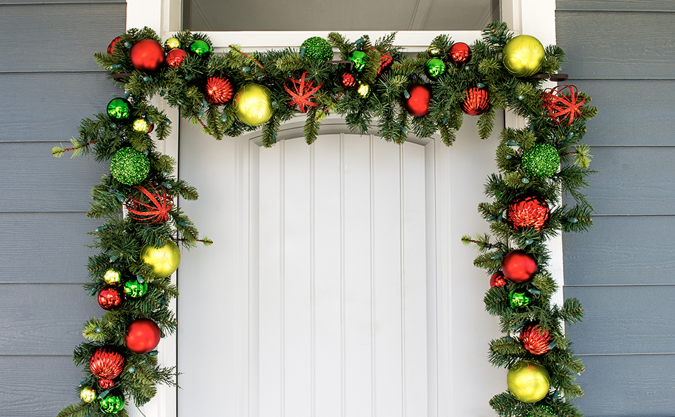 slim single door garland hanger hanging in door frame with a garland on it
