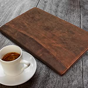Leather Padfolio on a table with coffee cup
