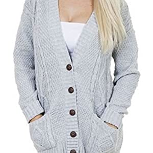 Grey color knitted caridgan on a model featuring front button long sleeses  and front v neck 51b1518e2