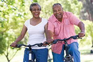 happy couple riding bikes