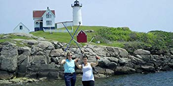 Lauren Delong with walking partner in front of the Nubble Light House in York Maine