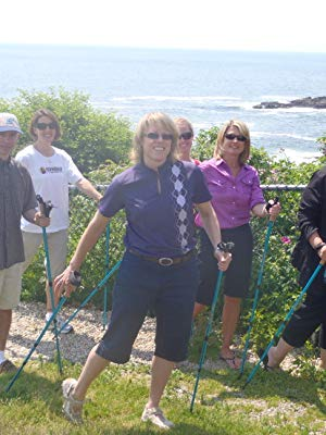 Group of outdoor enthusiasts with York Nordic walking poles at the beach