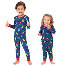 toddler and infant wearing matching pjs