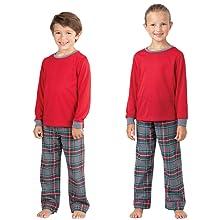 Boy and girl wearing matching pajamas