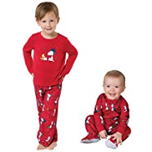 toddler and baby wearing matching snoopy christmas pjs