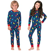 boy and girl wearing matching Christmas pajamas