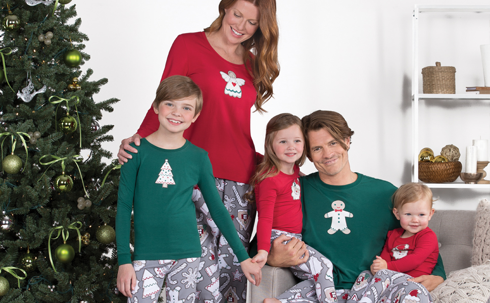 260a5582da the entire family around the christmas tree wearing christmas cookie print matching  pajamas