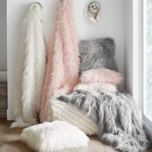 a hallway with decorating of faux fur pillows