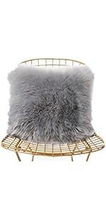 a grey faux fur pillow