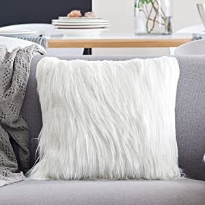 a faux fur pillow cover in the sofa