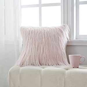 a pink new luxury faux fur pillow cove on the bench